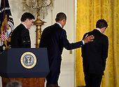 "United States President Barack Obama, center, departs after naming White House Chief of Staff Jacob ""Jack"" Lew, left, as Secretary of the Treasury to replace Timothy Geithner, right, in the East Room of the White House in Washington, D.C. on Thursday, January 10, 2013..Credit: Ron Sachs / CNP"