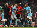 Nicolas Otamendi of Manchester City and Paul Pogba of Manchester United have an exchange during the premier league match at the Etihad Stadium, Manchester. Picture date 7th April 2018. Picture credit should read: Simon Bellis/Sportimage