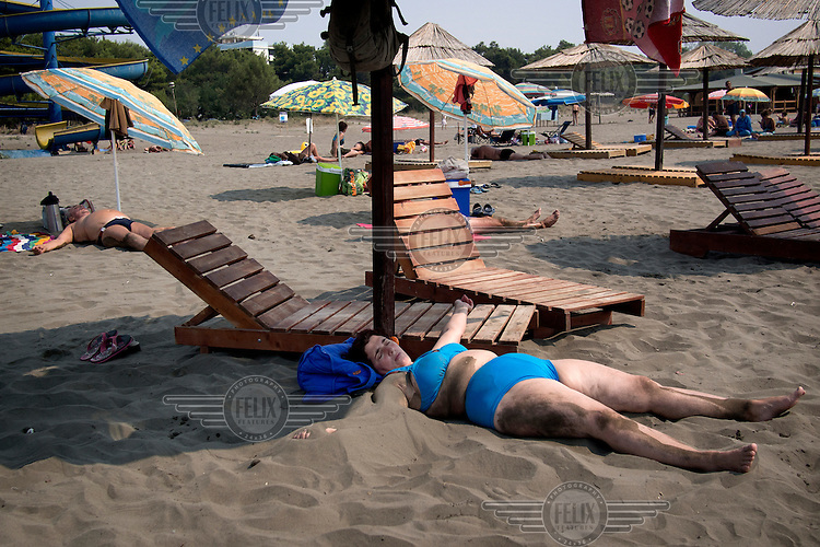 A woman sunbathes on Ulqin's 13 kilometre long 'Big beach'. Ulqin is the traditional holiday place for Kosovo Albanian families, although recent years have seen an influx of Bosniaks (Bosnian muslims) in what may be a reflection of the lack of reconciliation in post-war Balkan societies....