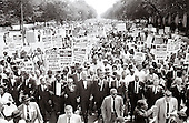 Leaders of the 1963 March on Washington for Jobs and Freedom hold hands as they lead a crowd of hundreds of thousands in Washington DC, August 28, 1963. Leaders in the front row include James Meredith, Dr. Martin Luther King, Jr., Rabbi Joachim Prinz,  Whitney Young, Roy Wilkins (light-colored suit);  A. Phillip Randolph; and Walter Reuther. <br /> Credit: Arnie Sachs / CNP