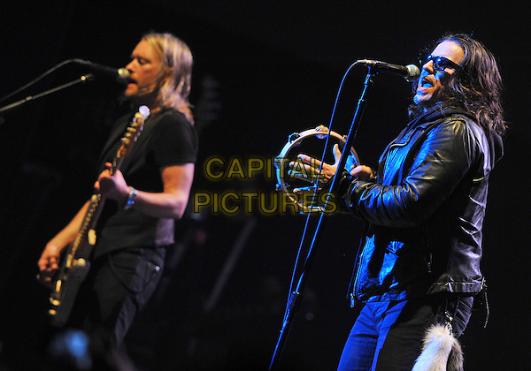 "Lead vocalist IAN ASTBURY and bassist CHRIS WYSE of the legendary British rock band THE CULT perform at a stop on their 2012 U.S. Tour to support their new album ""Choice of Weapon"" held at the Stage AE, Pittsburgh, PA., USA..3rd June 2012 .on stage in concert live gig performance music half length black leather jacket guitar tambourine singing sunglasses shades.CAP/ADM/DS.©Devin Simmons/AdMedia/Capital Pictures."