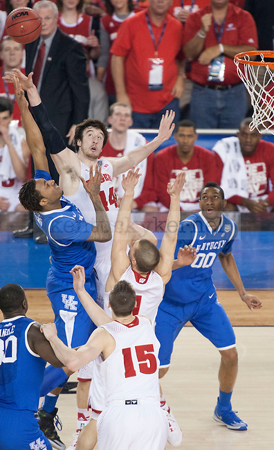 Wisconsin Badgers forward Frank Kaminsky (44) blocks Kentucky Wildcats guard/forward James Young (1) during the NCAA Final Four vs. Wisconsin at the AT&T in Arlington, Tx., on Saturday, April 5, 2014. Photo by Eleanor Hasken | Staff
