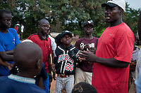 Coach George Mukhobe talks to players during baseball practice at sports field of St. Peter's School in Nsambya, neighbourhood of Kampala, Uganda on July 28 2011.
