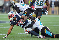 Jacksonville Jaguars cornerback A.J. Bouye (21) tackles New England Patriots running back James White (28) in the AFC Championship game Sunday, January 21, 2018 in Foxboro, MA.  (Rick Wilson/Jacksonville Jaguars)