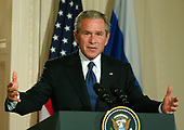 Washington, D.C. - September 16, 2005 -- United States President George W. Bush answers a reporter's question during a joint press conference with President Vladimir Putin of the Russian Federation in the East Room of the White House in Washington, D.C. on September 16, 2005 after their bi-lateral talks.<br /> Credit: Ron Sachs / CNP