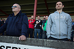 Visiting fans in the away end watching the first-half action as East Stirlingshire take on Edinburgh City in the second leg of the Scottish League pyramid play-off at Ochilview Park, Stenhousemuir. The play-offs were introduced in 2015 with the winners of the Highland and Lowland Leagues playing-off for the chance to play the club which finished bottom of Scottish League 2. Edinburgh City won the match 1-0 giving them a 2-1 aggregate victory making them the first club in Scottish League history to be promoted into the league.