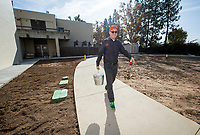 Tom Polansky, Associate VP of Facilities, carries a bucket of water from Taylor Pool to put in the new pool of the De Mandel Aquatic Center at Occidental College, Dec. 12, 2019.<br /> (Photo by Marc Campos, Occidental College Photographer)