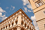 Looking up at buildings in downtown Trieste, Italy
