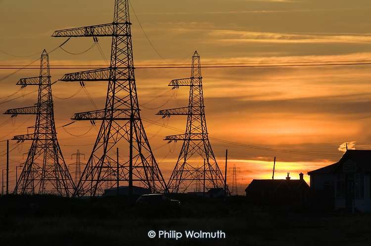 Electricity pylons at Dungeness Nuclear Power Station, Kent. Dungeness B is an Advanced Gas Cooled Reactor; the older Dungeness A Magnox reactor was decommissioned in 2006.