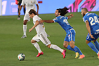 2nd July 2020, Madrid, Spain;  Real Madrids Luca Modric breaks from Getafes Marc Cucurella  during the Spanish league football match between Real Madrid and Getafe in Madrid, Spain