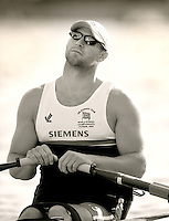Poznan, POLAND, ASM1X, Tom AGGAR, exercises his neck before competing in the heats of the AS men's single scull, on the Second day of the, 2009 FISA World Rowing Championships. held on the Malta Rowing lake, Monday 24/08/2009 [Mandatory Credit. Peter Spurrier/Intersport Images] ; Adaptive.