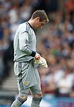 Allan McGregor clutches his groin after injury