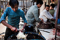 Butchers cull fowl in Crawford Market, Mumbai, India. Photo by Suzanne Lee