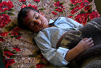 "Hilla, Iraq, April 2, 2003.Hilla Hospital, Hader Ahmed Jassim, 7, was wounded in his house in ""Nader 3"" village by a US cluster bomb. Hader suffer from severe concussion and his shell-shocked."