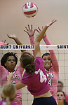 Marymount's Cailyn Thomas and Emileigh Rettig go up for a block during a college volleyball match against Shenandoah at Marymount University in Arlington, Vir., on Tuesday, Oct. 8, 2013.<br /> Photo by Cathleen Allison