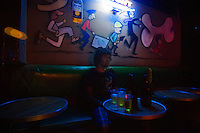 """Interior design of a bar at the red zone area. Northern Mexico is very polarized in sense of social status. In the red zone of Ensenada - """"El Bajio"""", people of considered """"low-class"""" have their share of night life. Alcoholics, prostitutes, drug junkies and the simple survivors find cheap beer and  entertainment.."""