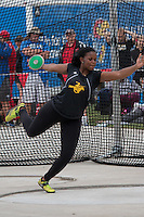 Lutheran South senior CeCilya Johnson spins in the ring on her way to victory in the girls discus with an 11-foot personal best throw of 154-08 to win by nearly six feet at the 2015 Kansas Relays.