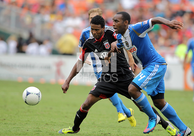 WASHINGTON, D.C. - AUGUST 19, 2012:  Lionard Pajoy (26) of DC United holds off Amobi Okugo (14) of the Philadelphia Union during an MLS match at RFK Stadium, in Washington DC, on August 19. The game ended in a 1-1 tie.