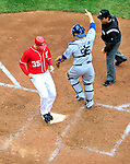 24 April 2010: Washington Nationals' pitcher Craig Stammen crosses the plate to score but the run did not count as Nyjer Morgan was called out at third base a moment before for the 3rd out of the inning by the Los Angeles Dodgers at Nationals Park in Washington, DC. The Dodgers edged out the Nationals 4-3 in a thirteen inning game. Mandatory Credit: Ed Wolfstein Photo