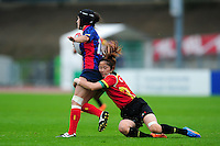 Hua Song of PR China puts in a tackle. FISU World University Championship Rugby Sevens Women's 7th/8th place match between Spain and PR China on July 9, 2016 at the Swansea University International Sports Village in Swansea, Wales. Photo by: Patrick Khachfe / Onside Images
