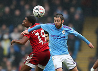 26th January 2020; Etihad Stadium, Manchester, Lancashire, England; English FA Cup Football, Manchester City versus Fulham; Ivan Cavaleiro of Fulham and Bernardo Silva of Manchester City compete for the ball in the air