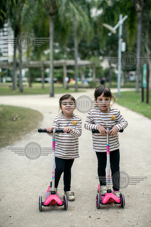 Twins three-year-olds Manuela and Mariana ride their scooters on a path in Peninsula, an exclusive planned community complex of high-end, high-rise condominiums. <br /> <br /> Breakneck development has brought problems similar to those of which its new middle class residents were fleeing, including congested traffic and untreated sewage in what was supposed to be a new model for urban living.