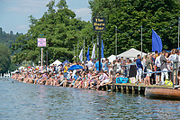 """Henley on Thames, United Kingdom, 3rd July 2018, Saturday,  """"Henley Royal Regatta"""",  Spectators, sitting on the River bank, keeping cool"""", Henley Reach, River Thames, Thames Valley, England, UK."""