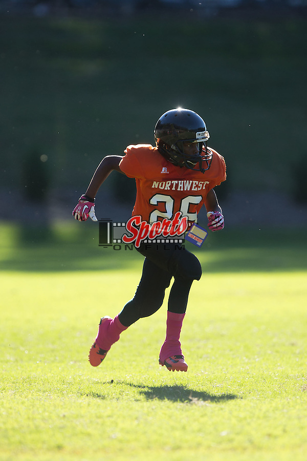 DeAvion Pless (28) of the Northwest Cabarrus Titans on special teams  against the Winkler Wolves in 7th grade football action at Trojan Stadium October 7, 2014, in Concord, North Carolina.  The Titans defeated the Wolves 58-30.  (Brian Westerholt/Sports On Film)