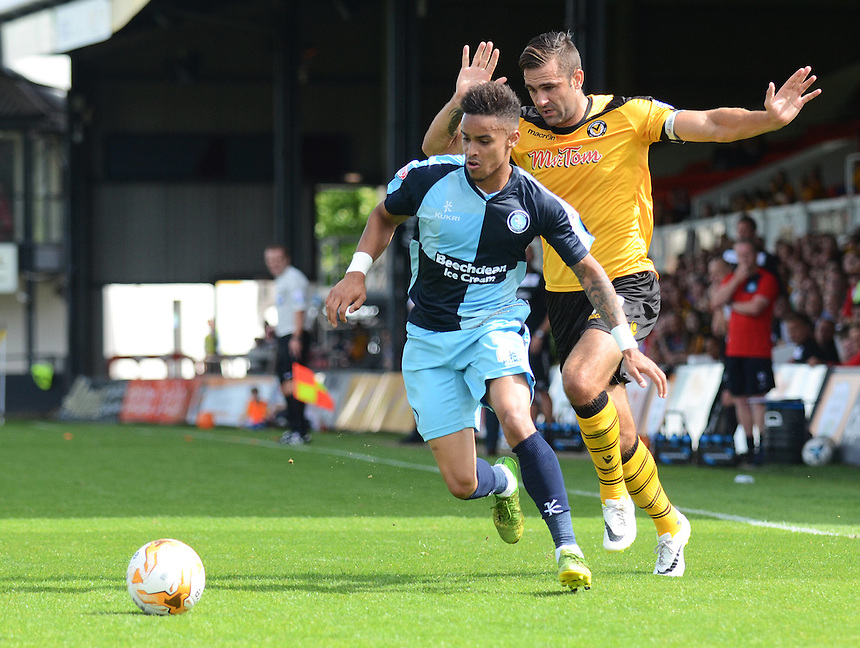 Wycombe Wanderers' Paris Cowan-Hall under pressure from Newport County's Andy Sandell<br /> <br /> Photographer Kevin Barnes/CameraSport<br /> <br /> Football - The Football League Sky Bet League Two - Newport County AFC v Wycombe Wanderers - Saturday 9th August 2014 - Rodney Parade - Newport<br /> <br /> &copy; CameraSport - 43 Linden Ave. Countesthorpe. Leicester. England. LE8 5PG - Tel: +44 (0) 116 277 4147 - admin@camerasport.com - www.camerasport.com