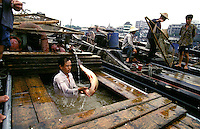 Fishermen unload fresh fish from their boats to take to the market in Guangzhou, China.