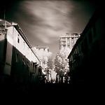 Dark shadows cast over town buildings.