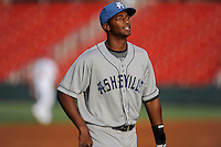 First baseman Correlle Prime (32) of the Asheville Tourists warms up before a game against the Greenville Drive on Monday, April 21, 2014, at Fluor Field at the West End in Greenville, South Carolina. Greenville won, 8-3. (Tom Priddy/Four Seam Images)