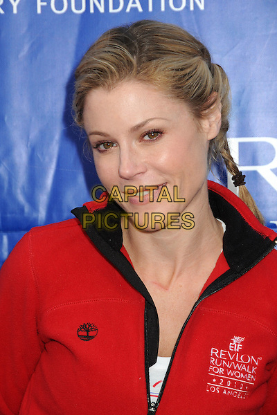 JULIE BOWEN.17th Annual EIF Revlon Run/Walk For Women held at the Los Angeles Memorial Coliseum, Los Angeles, California, USA..May 8th, 2010.full length white top red jacket black shorts trainers sneakers .CAP/ADM/BP.©Byron Purvis/AdMedia/Capital Pictures.