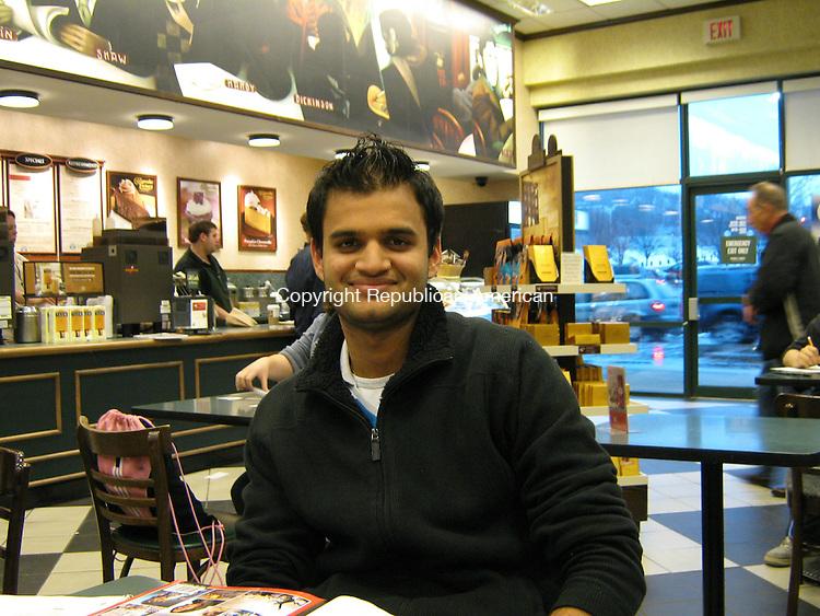 WATERBURY, CT - 26 Dec. 2009 - 122609AL01 - Himank Gupta, 21, of Waterbury, sits at a table at the Starbucks inside Barnes & Noble bookstore in Waterbury Saturday.