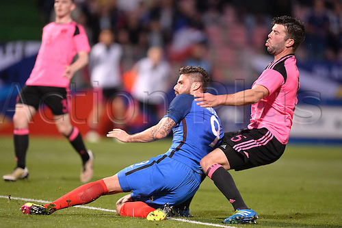 04.06.2016. Stade Saint Symphorien, Metz, France. International football freindly,France versus Scotland.  OLIVIER GIROUD challenged by Grant Hanley but he scores despite the attention