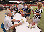 Dick Vermeil smiles as a fan and autograph-seeker takes a photo of him with her smartphone.