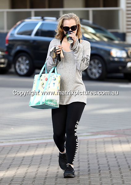 29 APRIL 2017 SYDNEY AUSTRALIA<br /> WWW.MATRIXPICTURES.COM.AU<br /> <br /> EXCLUSIVE PICTURES<br /> <br /> Jessica Marais pictured on a coffee run in Sydney. <br /> <br /> Note: All editorial images subject to the following: For editorial use only. Additional clearance required for commercial, wireless, internet or promotional use.Images may not be altered or modified. Matrix Media Group makes no representations or warranties regarding names, trademarks or logos appearing in the images.
