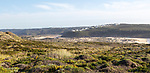 Panorama view of river Ribeira de Aljezur and whitewashed buildings of Clero village, Aljezur, Algarve, Portugal, Southern Europe