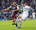 Raith Rovers' Dougie Hill stops Hearts' Calum Paterson.