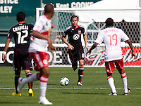Carey Talley (8) of D.C. United brings the ball upfield at RFK Stadium in Washington, DC.  The New York Red Bulls defeated D.CC United, 2-0.