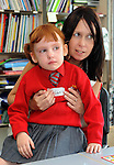 29-08-2013: Keelan O'Donoghue is comforted by her teacher Catherine Mangan on her first day at Holy Cross National School, Killarney on Thursday. Picture: Eamonn Keogh (MacMonagle, Killarney)
