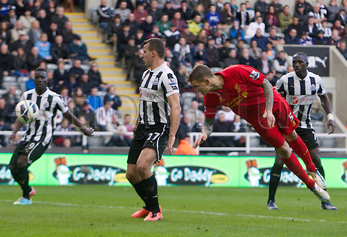 27.04.2013 Newcastle England.  Liverpool's Daniel Agger dives at the ball to put off Newcastle keeper Elliot and for Jordan Hendersons Freekick to go straight in  during the English Premier league game between Newcastle United and Liverpool,  From The Sports Direct Arena, St James Park, Stadium, Newcastle.