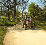 Teenage son being taught to drive tractor by his father, Island of Sark, Channel Islands, Great Britain
