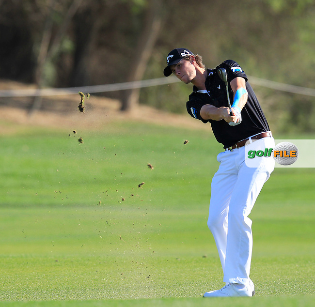 Thomas PIETERS (BEL) chips into the 10th green during Thursday's Round 2 of the 2015 Commercial Bank Qatar Masters held at Doha Golf Club, Doha, Qatar.: Picture Eoin Clarke, www.golffile.ie: 1/22/2015