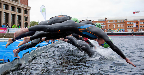 22 MAY 2011 - DUNKERQUE, FRA - Alistair Brownlee (EC Sartrouville) dives into the water at the start of the men's round of the 2011 French Grand Prix triathlon series (PHOTO (C) NIGEL FARROW)