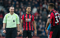 Callum Wilson of AFC Bournemouth & Referee Kevin Friend during the Premier League match between Bournemouth and Arsenal at the Goldsands Stadium, Bournemouth, England on 14 January 2018. Photo by Andy Rowland.
