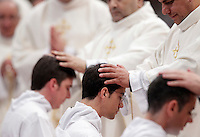 Sacerdoti impongono le mani sul capo degli ordinandi durante una ordinazione sacerdotale celebrata dal Papa nella Basilica di San Pietro, Citta' del Vaticano, 26 aprile 2015.<br /> Priests put their hands on the head of ordinands during an ordination mass celebrated by the Pope in St. Peter's Basilica at the Vatican, 26 April 2015.<br /> UPDATE IMAGES PRESS/Riccardo De Luca<br /> <br /> STRICTLY ONLY FOR EDITORIAL USE