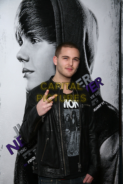 "JARED EVAN .Special Screening of ""Justin Bieber: Never Say Never"" at the Regal 42nd Street E-Walk Cinemas, New York, USA, 2nd February 2011..half length black leather jacket jeans hand v peace sign gesture  .CAP/LNC/TOM.©LNC/Capital Pictures."
