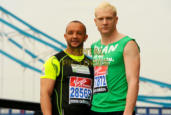 JAMIE BAULCH & IWAN THOMAS.Virgin London Marathon photocall, London, England..April 15th, 2011.exercise half length spandex black t-shirt green tank top white sleeveless .CAP/CJ.©Chris Joseph/Capital Pictures.