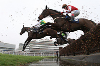 Larks Lad ridden by Barry Geraghty (L) and Romulus D'Artaix ridden by Robert Thornton take the water jump during the Colin Ruck-Nightingale Memorial Novices Handicap Chase  - Horse Racing at Newbury Racecourse, Berkshire